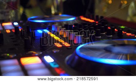 Close Up Of Dj Playing Party Music On Modern Cd Usb Player In Disco Club - Nightlife And Entertainme