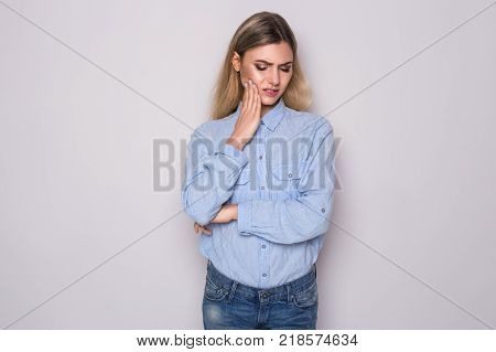 Woman Feeling Tooth Pain. Teeth Problem. Beautiful young woman suffering from toothache.