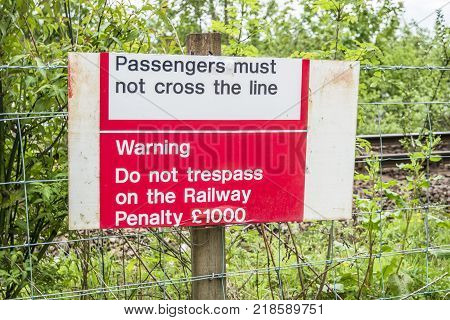 LOCH AWE, ARGYLL, Scotland - MAY 15 2017 : Sign warning not to tresspass the railway - Penalty 1000GBP
