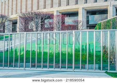 Outer wall of a modern object. Classical architecture. Glass fence.