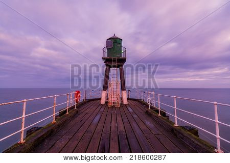 The historic West Pier beacon at Whitby North Yorkshire UK