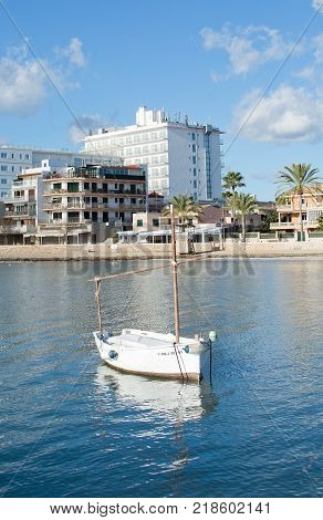 PLAYA DE PALMA, MALLORCA, SPAIN - DECEMBER 16, 2017: Llaut moored in peaceful bay on a sunny day on December 16, 2017 in Mallorca, Balearic islands, Spain