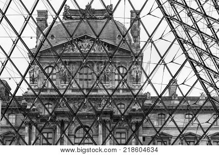 Paris France - July 01 2017: Architectural fragments of the Louvre building. Inside the glass pyramid of the Louvre museum. The Louvre Museum is one of the largest and most visited museums worldwide.