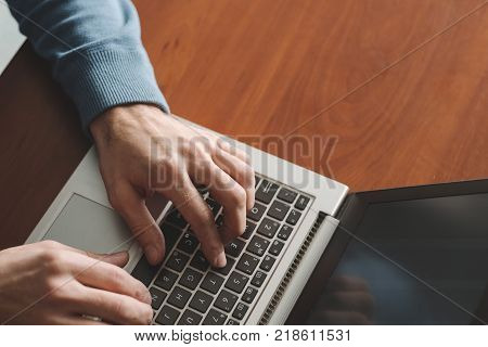 speed typing training. Man hands on the laptop keyboard. Improving office skills