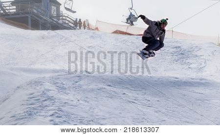 CHERKASSY, UKRAINE - February 23, 2017: Snowboard CUP, rider jumping on mountains. Extreme snowboard freeride sport