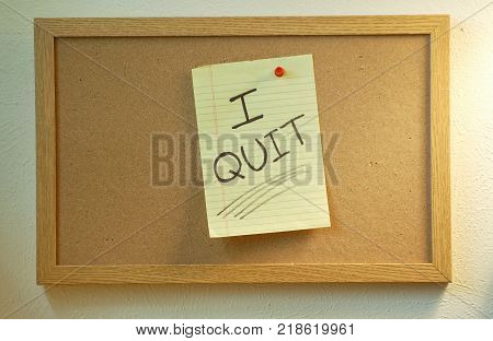 Bulletin Board with a Handwritten Note that says I Quit