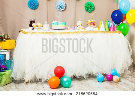 Decorated table in the room for Happy Birthday Party without people