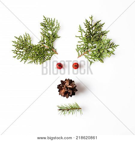 Reindeer Face from natural materials. Christmas deer silhouette picture in minimalistic design concept