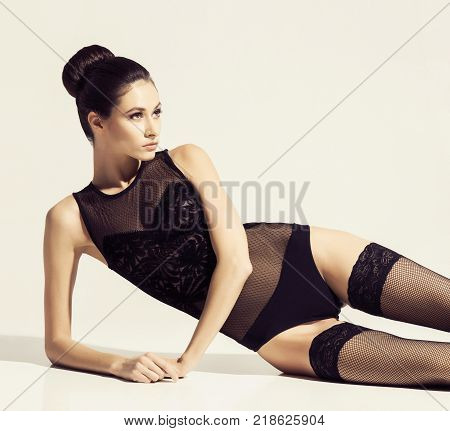 Fashion model posing in sexy lingerie. Beautiful woman in erotic underwear and stockings.
