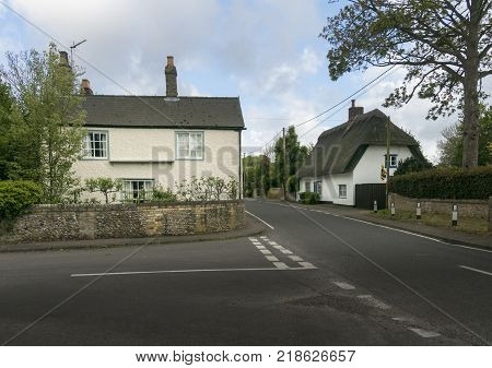 Street view of old cottages in the pretty village of Fowlmere Cambridgeshire England UK
