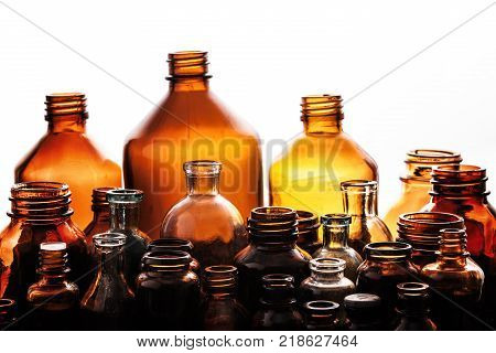 Various medical apothecary bottles on white background.