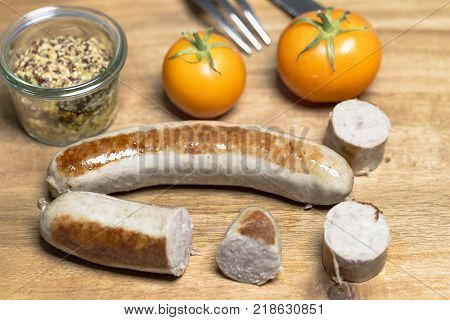 Country sausage with yellow tomato and coarse mustard