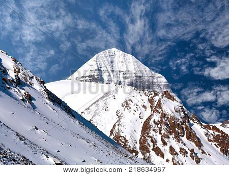 Sacred mount Kailash (elevation 6638 m) which are part of the Transhimalaya in Tibet. It is considered a sacred place in four religions: Bon Buddhism Hinduism and Jainism.