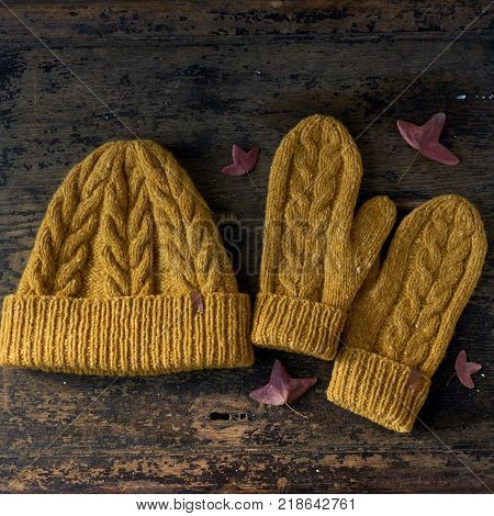 yellow knitted tweed hat with a pattern on a gray background