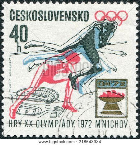 CZECHOSLOVAKIA - CIRCA 1971: A stamp printed in the Czechoslovakia dedicated to 20th Summer Olympic Games Munich shows the Women's high jump Olympic emblem and plan for Prague Stadium circa 1971