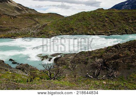 Rapids of the Salto Grande waterfall in Torres del Paine National Park between Lago Nordenskjold and Lago Pehoe