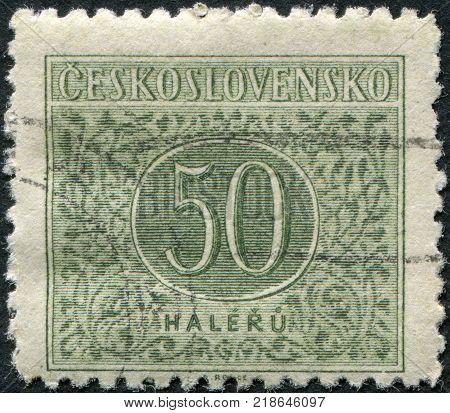 CZECHOSLOVAKIA - CIRCA 1955: A stamp printed in the Czechoslovakia shows a porto-mark circa 1955