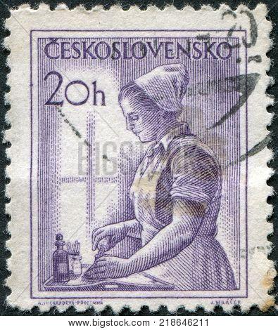 CZECHOSLOVAKIA - CIRCA 1954: A stamp printed in the Czechoslovakia, shows a nurse, circa 1954
