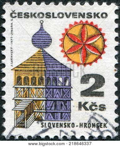 CZECHOSLOVAKIA - CIRCA 1971: A stamp printed in the Czechoslovakia shows a wooden clock tower in the village Hronsek circa 1971