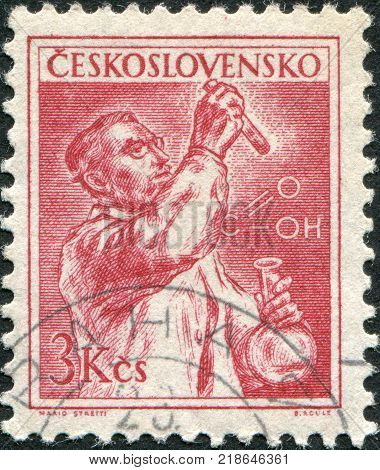CZECHOSLOVAKIA - CIRCA 1954: A stamp printed in the Czechoslovakia shows a chemist circa 1954