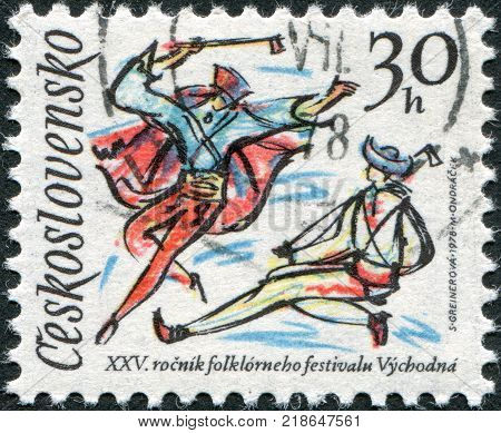 CZECHOSLOVAKIA - CIRCA 1978: A stamp printed in the Czechoslovakia dedicated to 25th Folklore Festival Vychodna shown Folk Dancers circa 1978