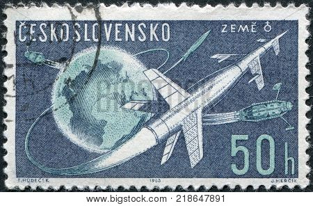 CZECHOSLOVAKIA - CIRCA 1963: A stamp printed in the Czechoslovakia, shows the space rocket flight around the Earth, circa 1963