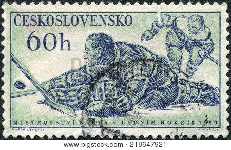 CZECHOSLOVAKIA - CIRCA 1959: A stamp printed in the Czechoslovakia shows the game of hockey circa 1959