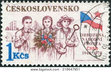 CZECHOSLOVAKIA - CIRCA 1978: A stamp printed in the Czechoslovakia is dedicated to the 30th anniversary of Victorious February shows the Intellectual Farm Woman and Steel Worker Flag circa 1978
