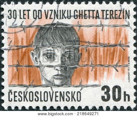 CZECHOSLOVAKIA - CIRCA 1972: A stamp printed in the Czechoslovakia shows the Terezin concentration camp Boy's head behind barbed wire circa 1972