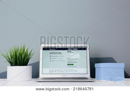 KYIV, UKRAINE - OCTOBER 26, 2017: Apple MacBook Air with Facebook homepage on screen. Facebook is world famous social network