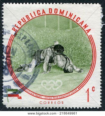 DOMINICAN REPUBLIC - CIRCA 1960: A stamp printed in the Dominican Republic the Olympic champion Sholam Takhti Iran Lightweight Wrestling circa 1960