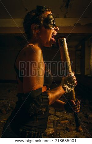 Mad postapocalyptic raider licking his deadly bat