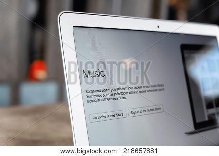 KIEV, UKRAINE - SEPTEMBER 25, 2017: Apple MacBook Air with iTunes on screen, closeup