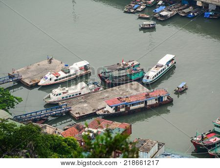 Ha Long Vietnam - May 23 2016. Ferries docking at jetty in Ha Long Vietnam. Ha Long a city on Vietnam northern coast is a jumping-off point for Ha Long Bay.