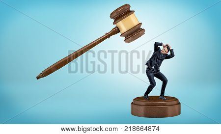 A small businessman tries to avoid a giant gavel strike while standing on a sound block. Business lawsuit. Corporate law. Caught guilty.