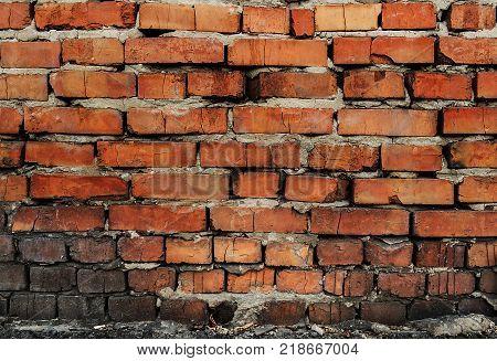 Old brick wall. Brown brick wall. Grunge brick wall.Grunge brick. Brick background. Brick texture. Firebrick. Old brickwork.
