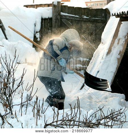 Boy shoveling snow. Winter, cold, shovel and village.