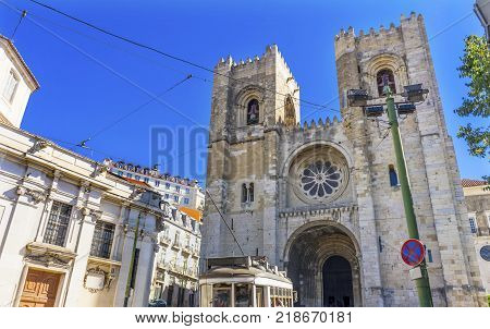 LISBON, PORTUGAL - SEPTEMBER 12, 2017 The Se Sedes Episcopalis Cathedral Trolley Lines Lisbon Portugal. The Cathedral was built in 1155 after Lisbon was taken from the Moors. Removated in 1755 aftr the earthquake.