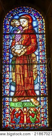 LISBON, PORTUGAL - SEPTEMBER 12, 2017 Saint Antony Jesus Book Stained Glass Basilica The Se Sedes Episcopalis Cathedral Lisbon Portugal. Saint Antony is Patron Saint of Portugal. The Cathedral was built in 1155 after Lisbon was taken from the Moors.
