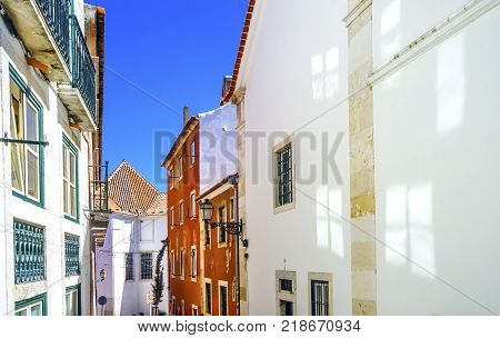 White Narrow Street Portas do Sol Alfama Lisbon Portugal. White Buiildings Narrow Street