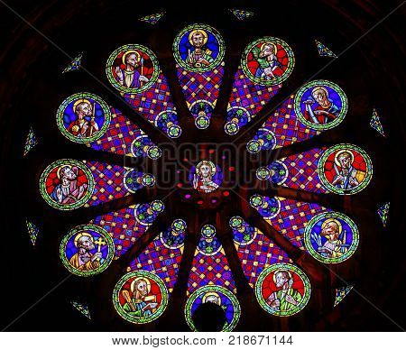 LISBON, PORTUGAL - SEPTEMBER 12, 2017 Rose Window Stained Glass Jesus Disciples Basilica The Se Sedes Episcopalis Cathedral Lisbon Portugal. The Cathedral was built in 1155 after Lisbon was taken from the Moors. Removated in 1755 after the earthquake.