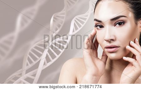 Young sensual woman with vitiligo in DNA chains over beige background. Biochemistry skin concept.