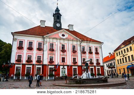 TARTU, ESTONIA - SEPTEMBER 10, 2016: Central square in old historical town Tartu, Estonia. Cloudy day with unidentified people. Town hall square