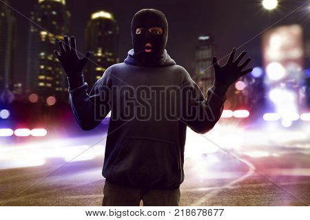 Masked thief caught on the street at night poster