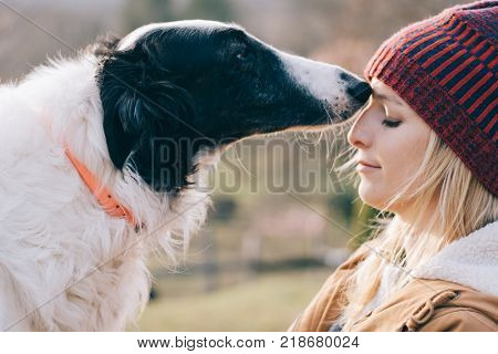 Girl and her dog having fun together.