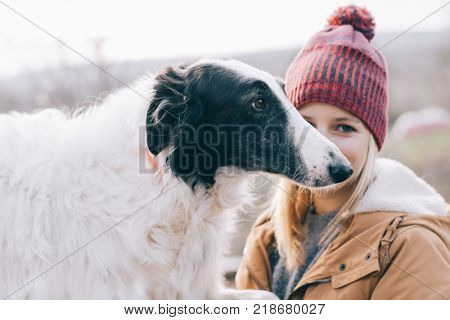 Young woman and her dog having fun together.