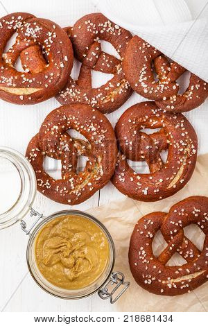 A few salty pretzels with mustard. Freshly baked homemade soft pretzels