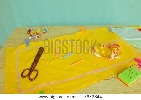 Tools for sewing for hobby set on wooden table background top view. Sewing kit. Thread needles and cloth. tailor workspace with sewing and handmade tools. copy space image of sewing tools - Retro color