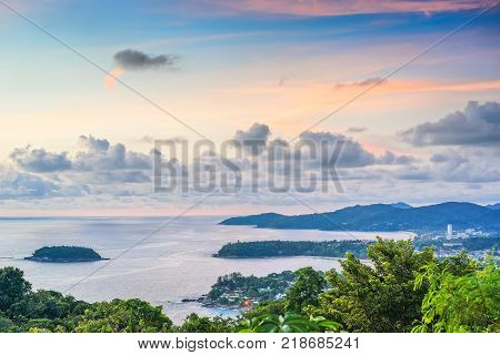 Landscape with sea beaches tropical greenery at sunset on the background of blue sky with picturesque clouds. The view from the observation platform of the island of Phuket Thailand