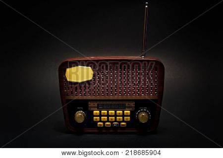 Vintage retro look MP3 player on isolated Black Background. Good Old Memories Radio Transistor in present day. Low Key Photography